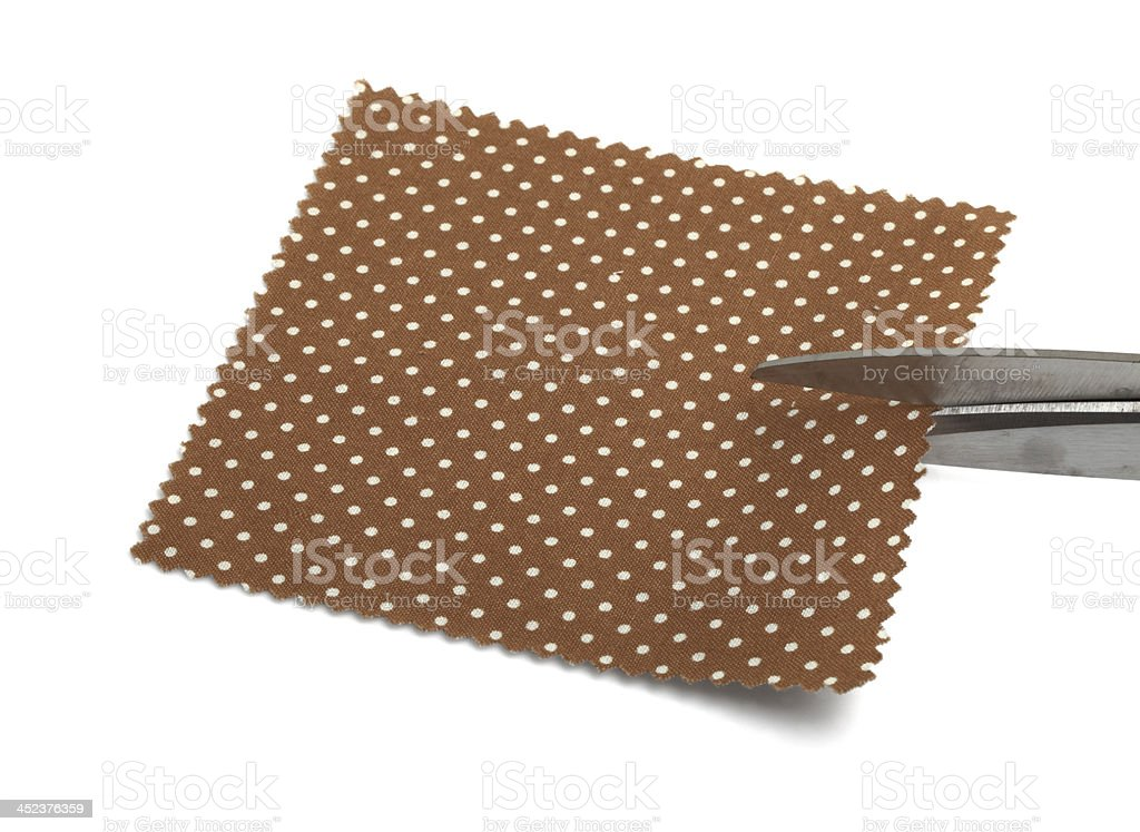 Cutting the Fabric Swatch royalty-free stock photo