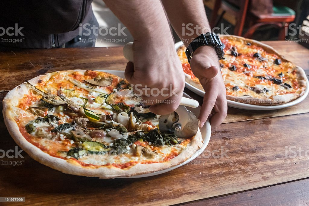 Cutting the Pizza stock photo