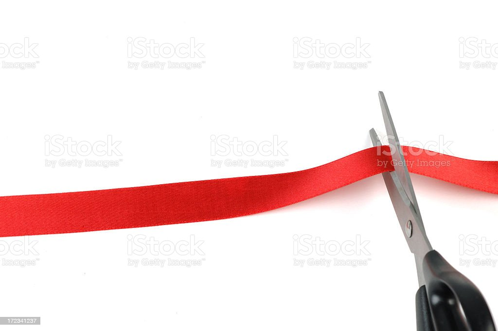 Cutting the red tape stock photo