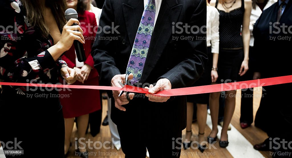 Cutting the ribbon royalty-free stock photo