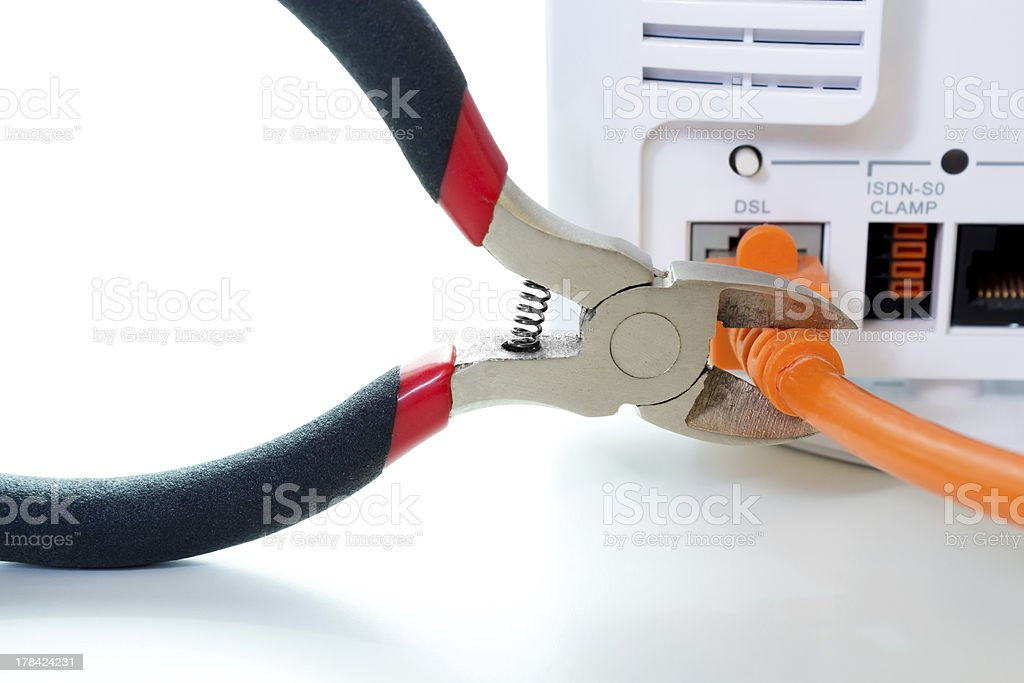Cutting through DSL cable stock photo