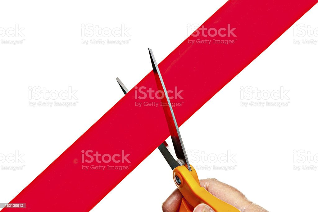 Cutting Through Red Tape Isolated On White royalty-free stock photo