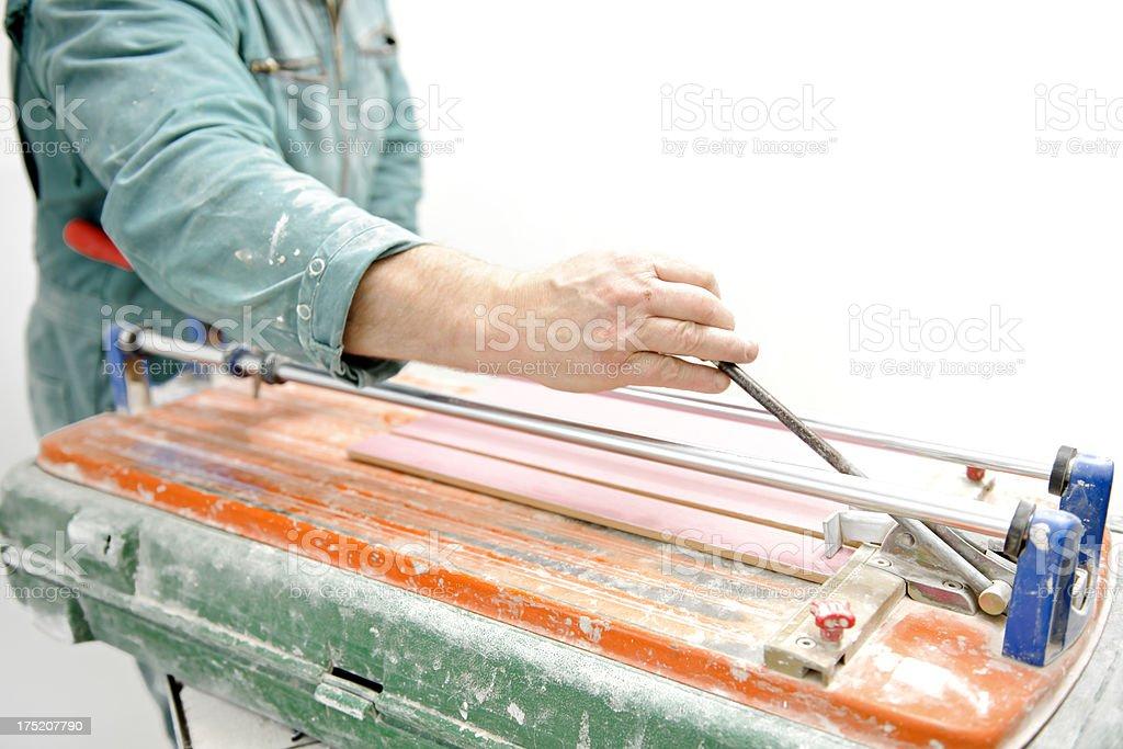cutting tile stock photo