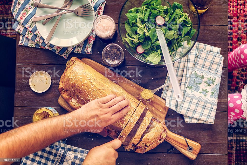 Cutting Toad-in-a-Hole Meat Pie stock photo
