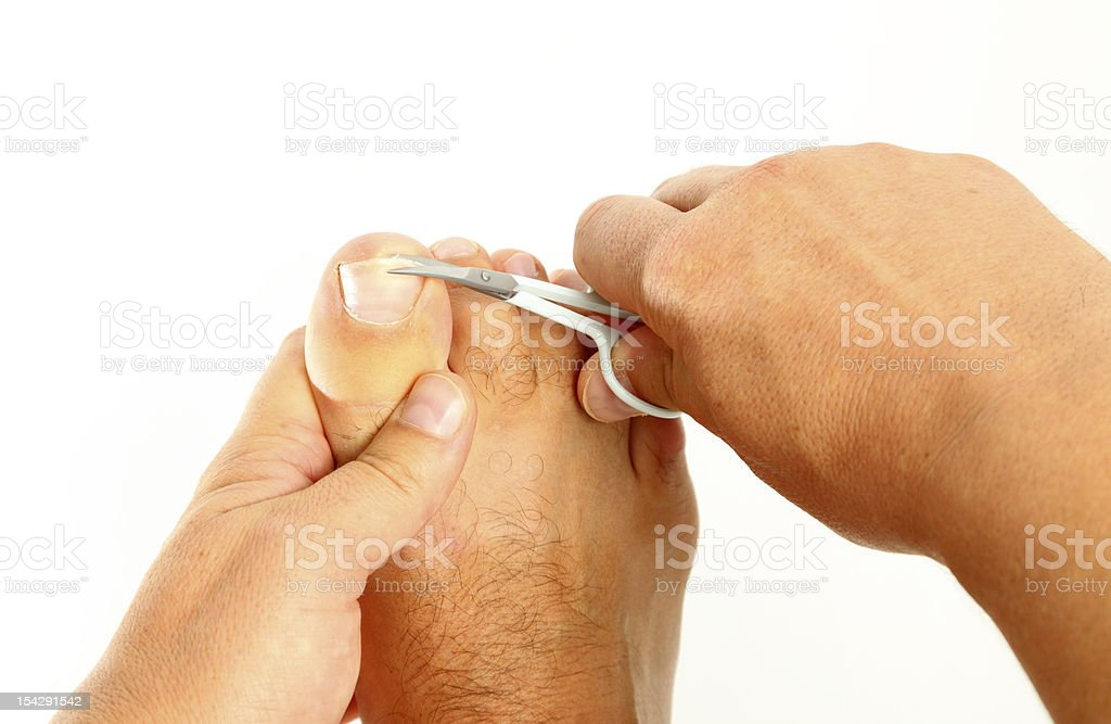 Cutting toenails royalty-free stock photo