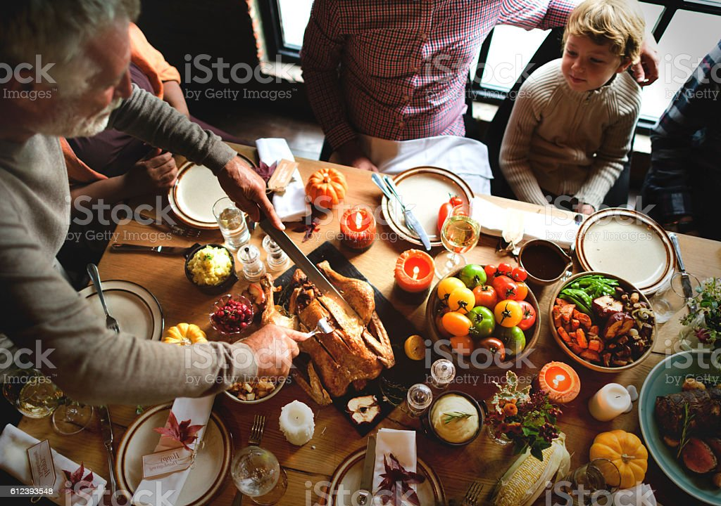 Cutting Turkey Thanksgiving Celebration Concept stock photo