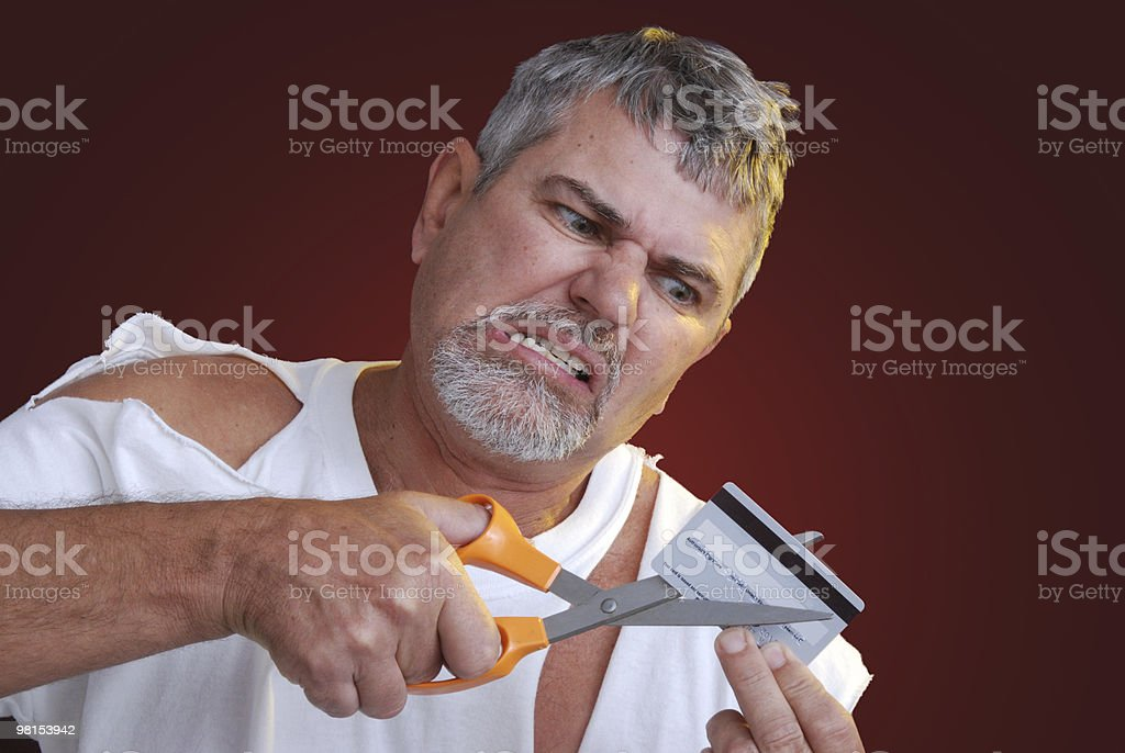 Cutting Up Credit Card - Bad Debt stock photo