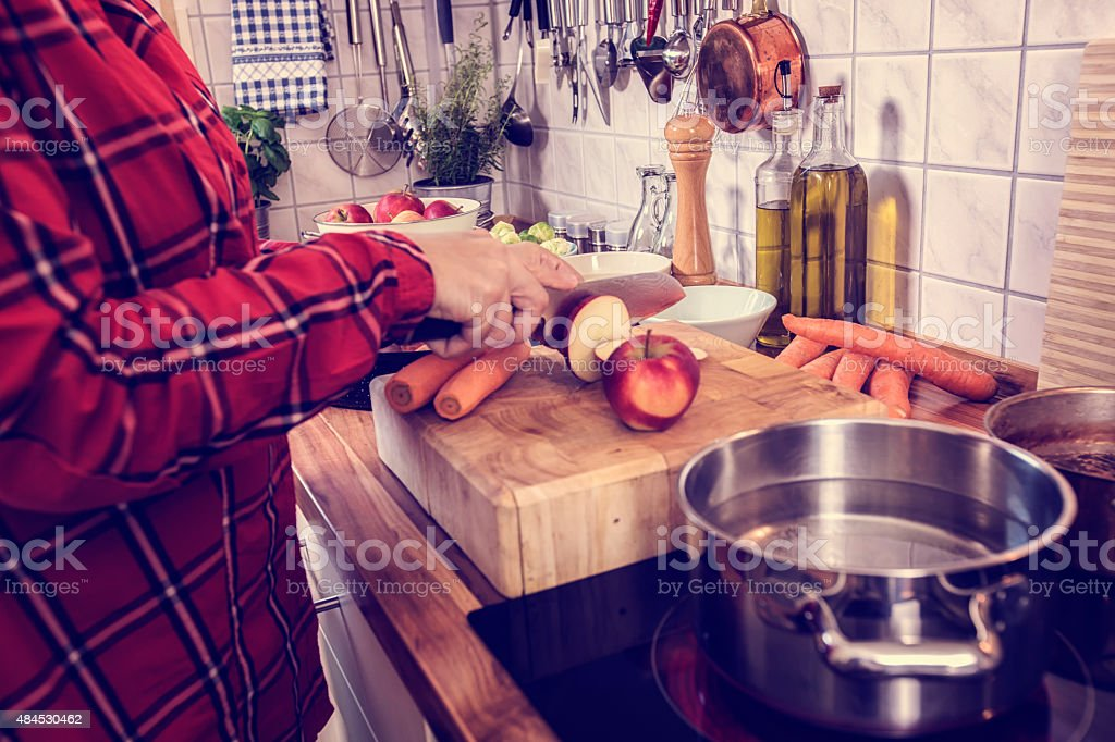 Cutting Vegetables for Traditional Holiday Goose stock photo