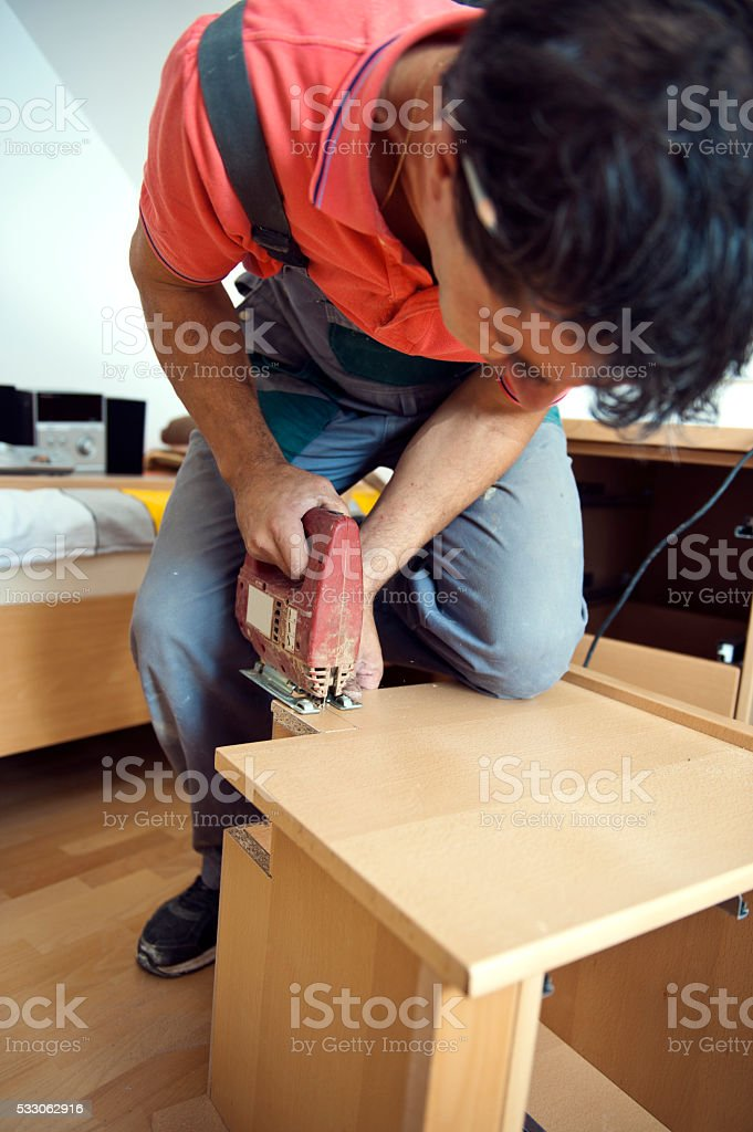 Cutting with jigsaw stock photo