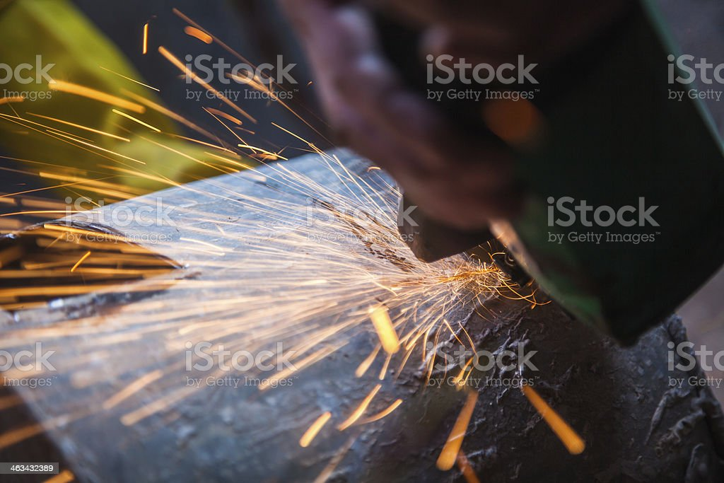 cutting with red sparks stock photo