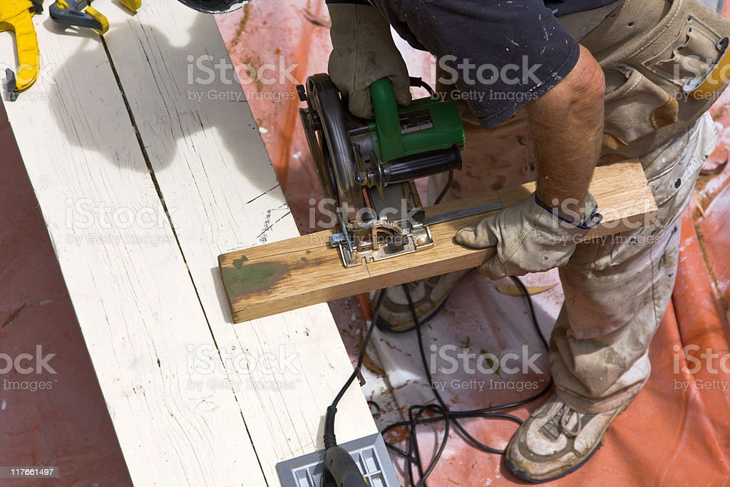 Cutting wood with a circular saw royalty-free stock photo