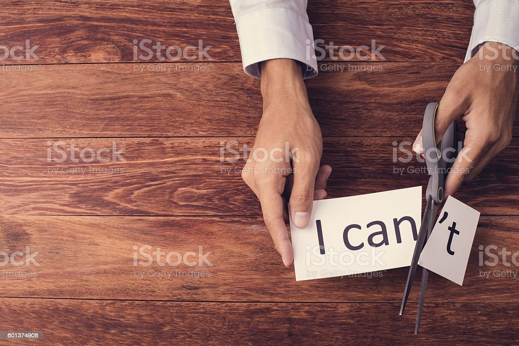 Cutting word 'I can't' flat lay stock photo