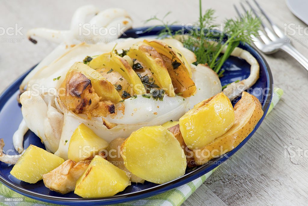 cuttlefish with potatoes and apples stock photo