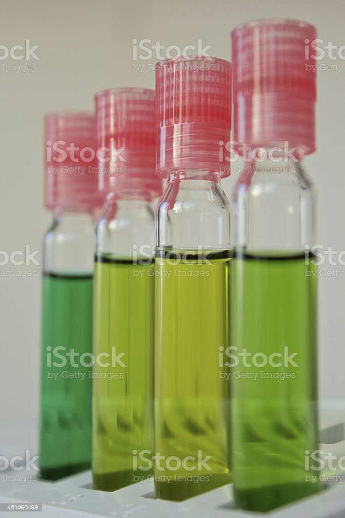 Cuvette with green tracer - Micropollutants stock photo