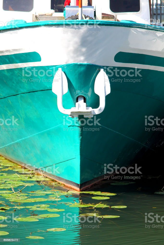 Cyan bow with white anchor. stock photo