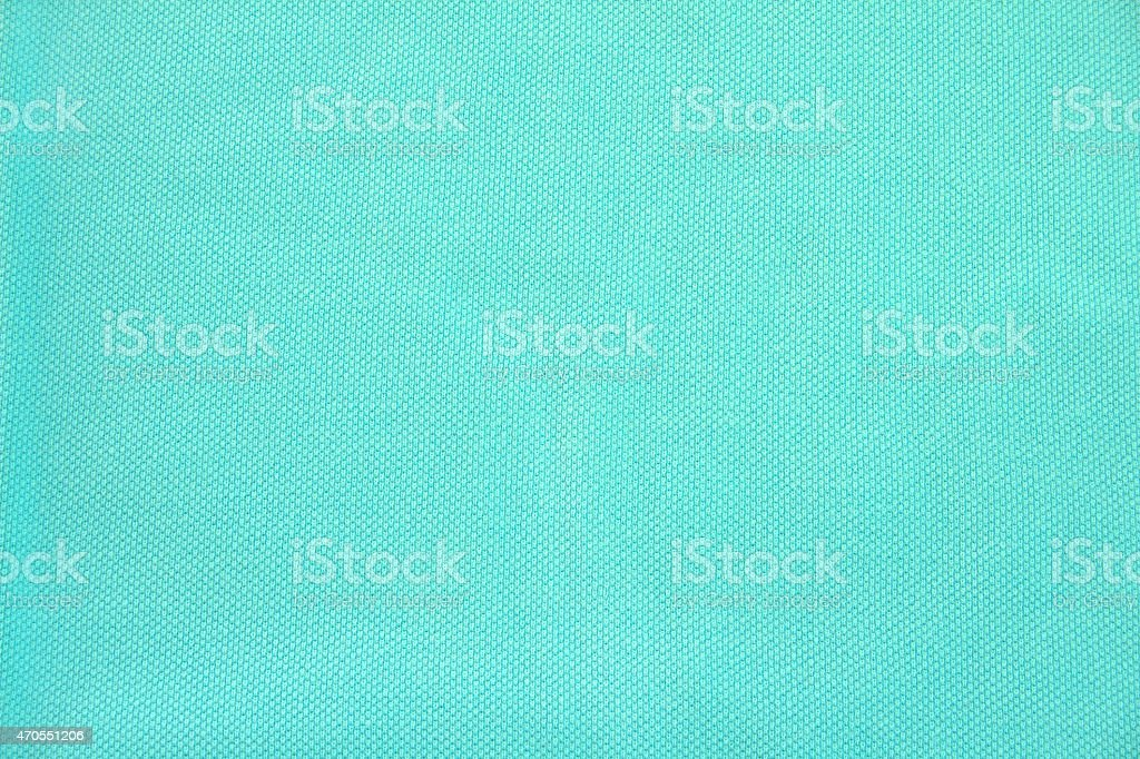 Cyan Polo Shirt Piqué material cloth texture stock photo
