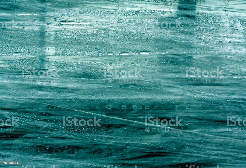 cyan PVC wrap surface with water drops stock photo
