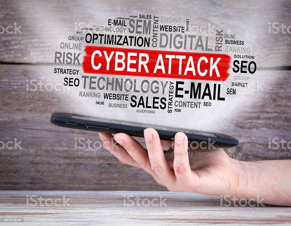 Cyber Attack concept. Tablet computer in the hand. stock photo