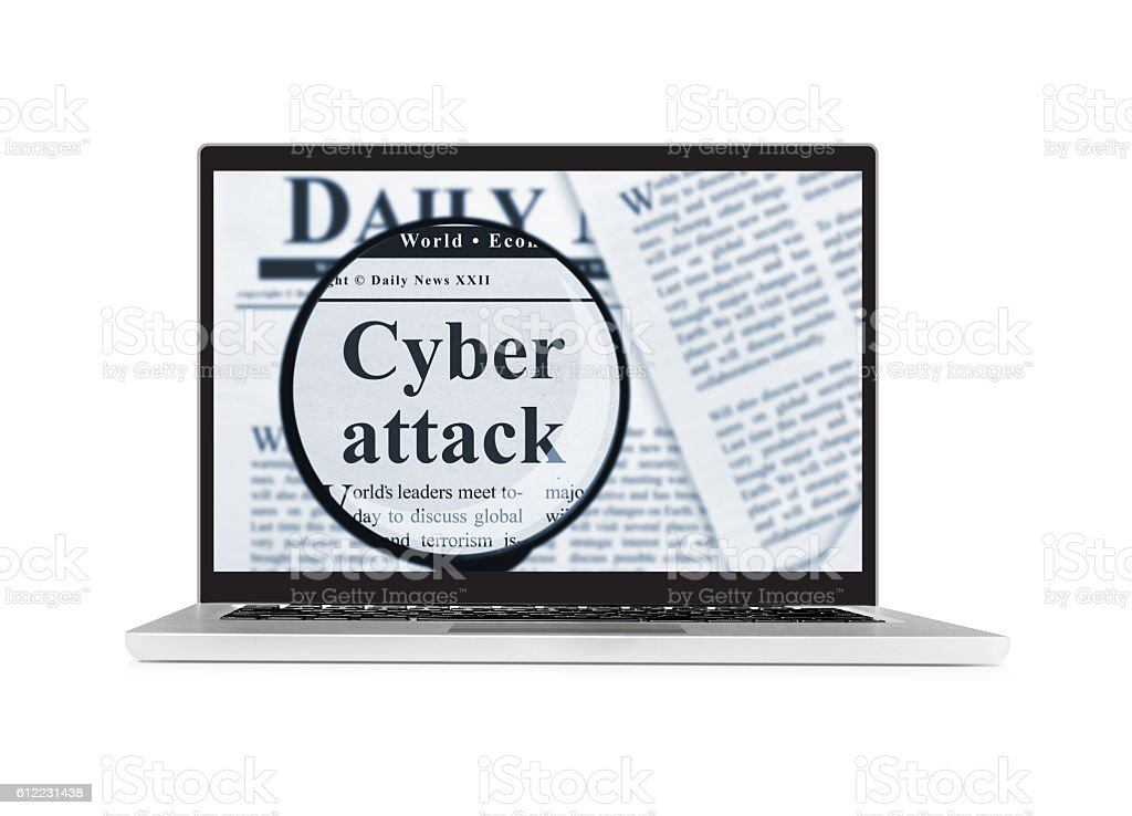 Cyber attack under magnifying glass on a laptop stock photo