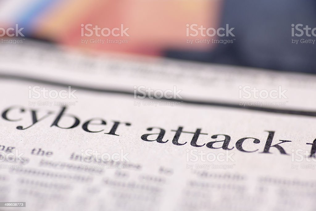 Cyber attack written newspaper stock photo