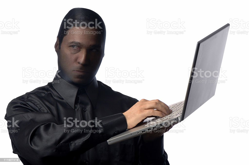 Cyber Identity Theft Mask Laptop Computer Isolated on White Background royalty-free stock photo