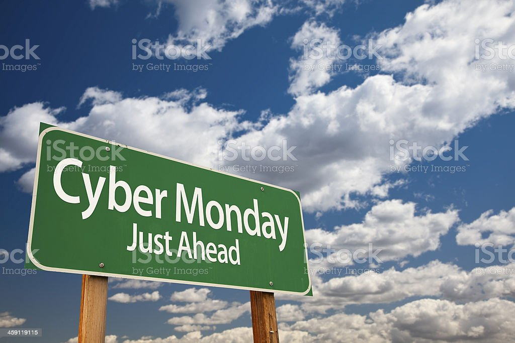 Cyber Monday Just Ahead Green Road Sign and Clouds royalty-free stock photo