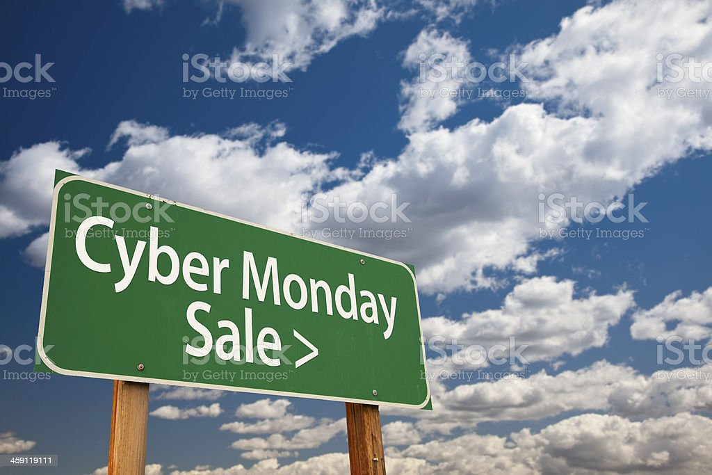 Cyber Monday Sale Green Road Sign and Clouds royalty-free stock photo