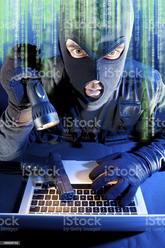 Cybercrime thief stealing data from laptop royalty-free stock photo