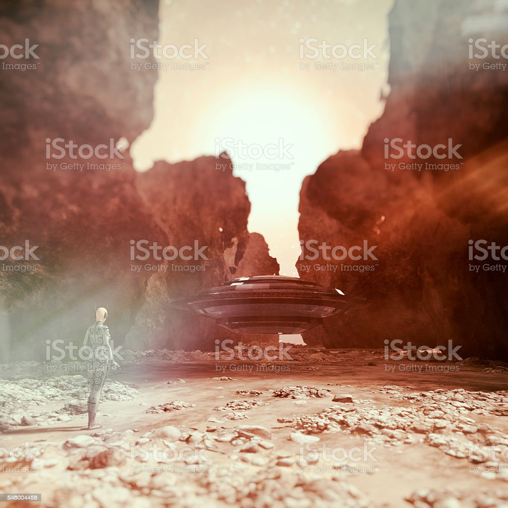 Cyborg walking towards UFO stock photo
