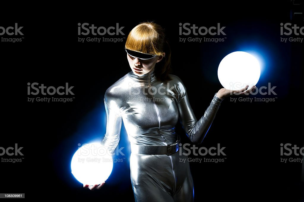 Cyborg woman holding energy balls royalty-free stock photo