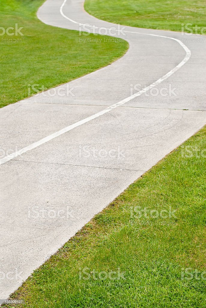 Cycle and pedestrian path through grassed area royalty-free stock photo