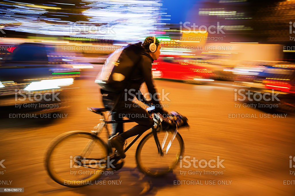 cycle courier in Paris, France, at night stock photo