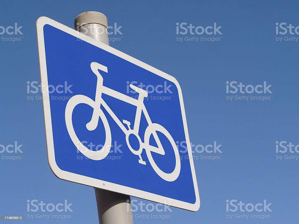 Cycle lane sign with a clear blue sky background royalty-free stock photo