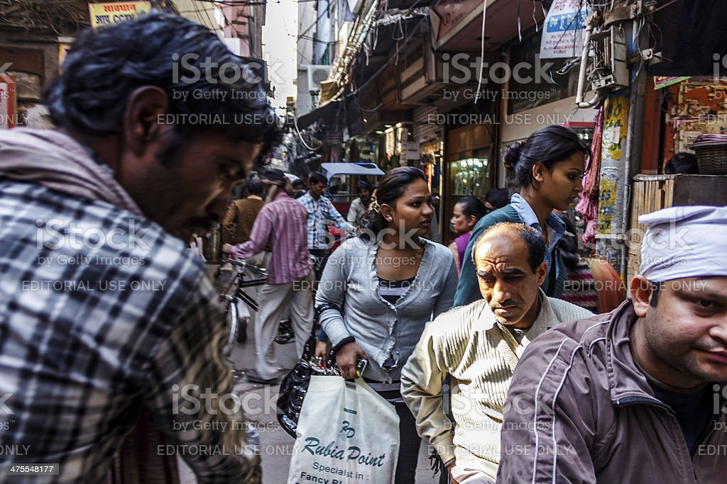 cycle rickshaw driver in a crowded lane stock photo