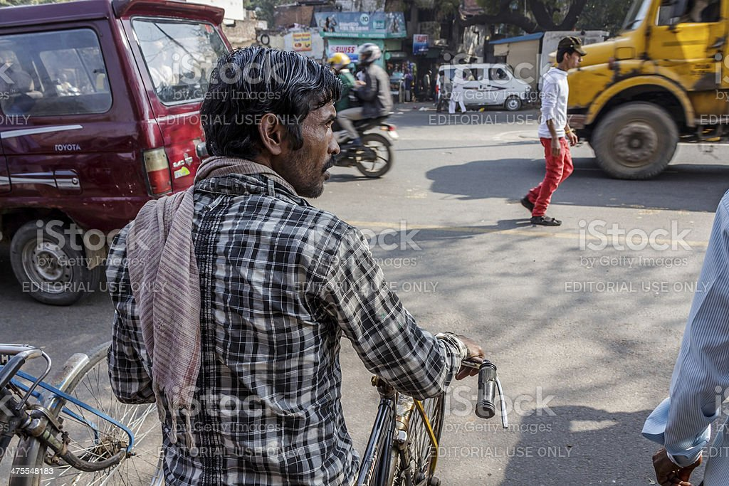 cycle rickshaw driver in crossing stock photo
