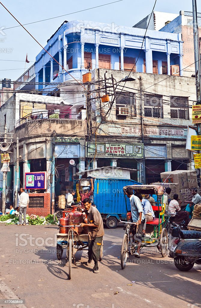 cycle rickshaw driver with load in Chawri Bazar stock photo