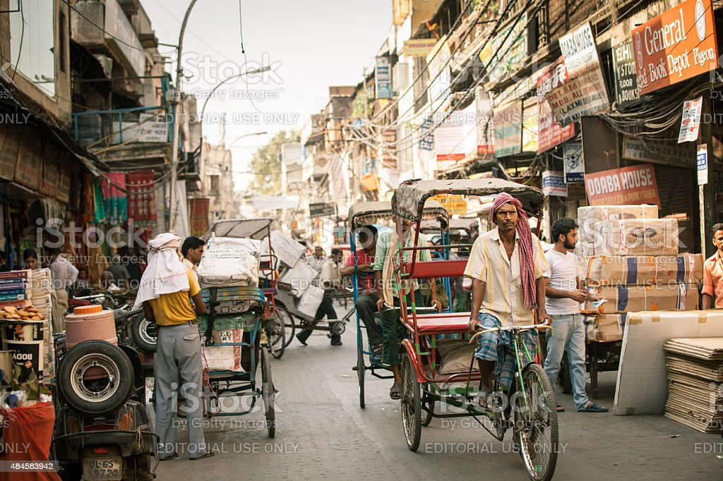 Cycle rickshaws on the street of Old Delhi, India stock photo