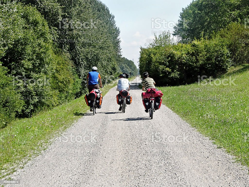 Cycle tourists in country lane stock photo