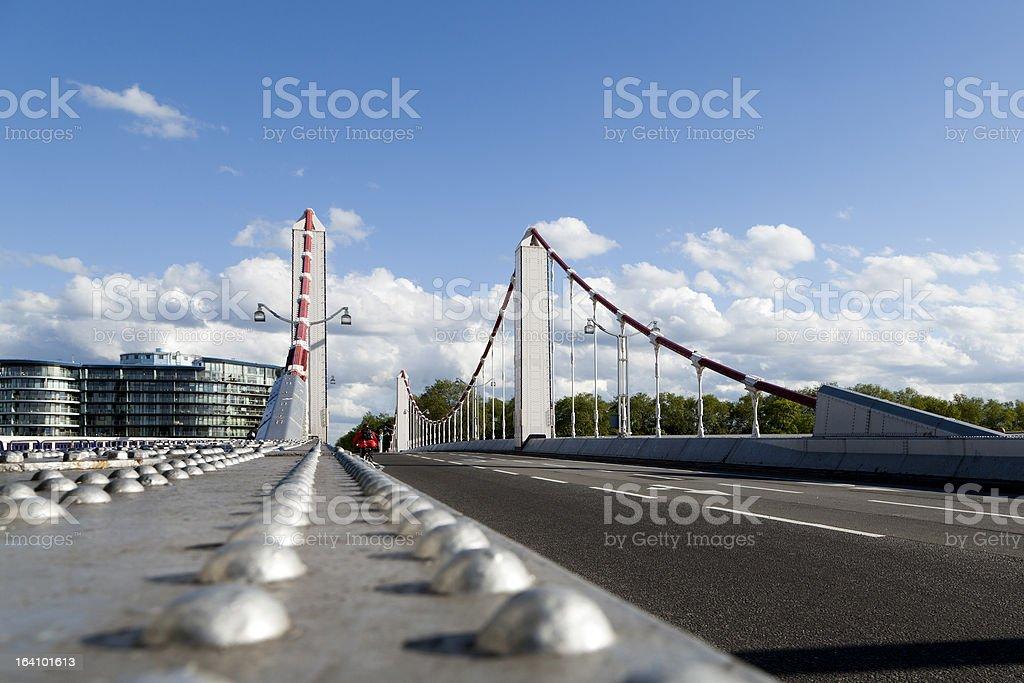 Cycling along Chelsea Bridge in Battersea, London stock photo