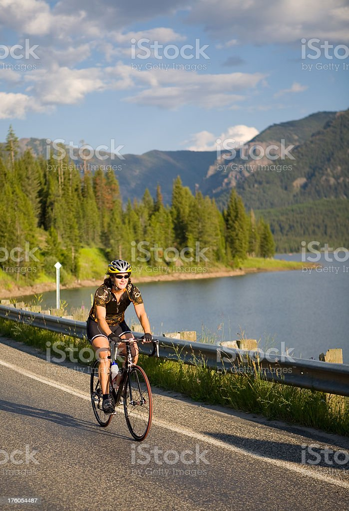 Cycling at Dusk in Beautiful Mountains stock photo