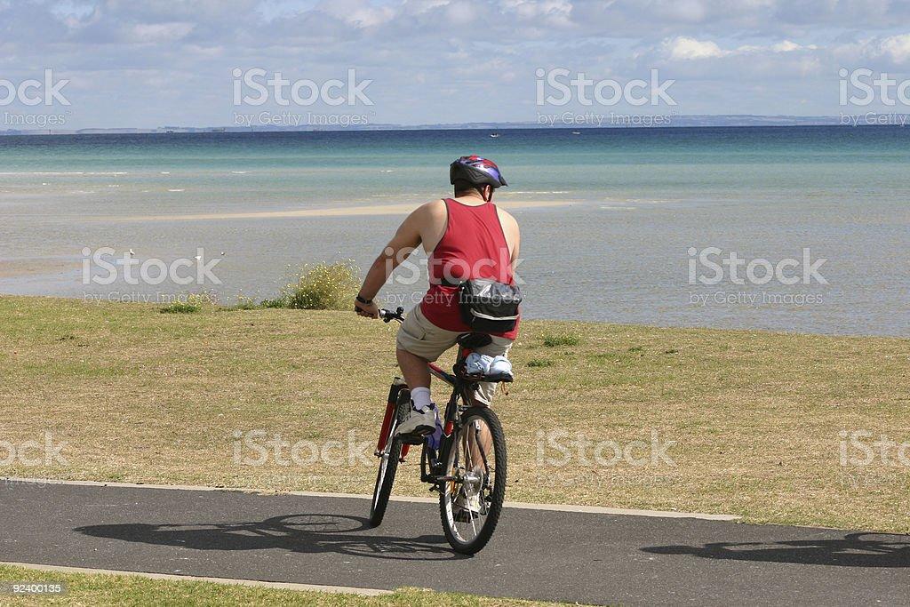 cycling at the beach royalty-free stock photo