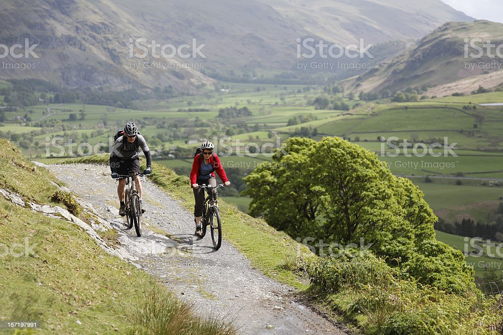 Cycling couple royalty-free stock photo