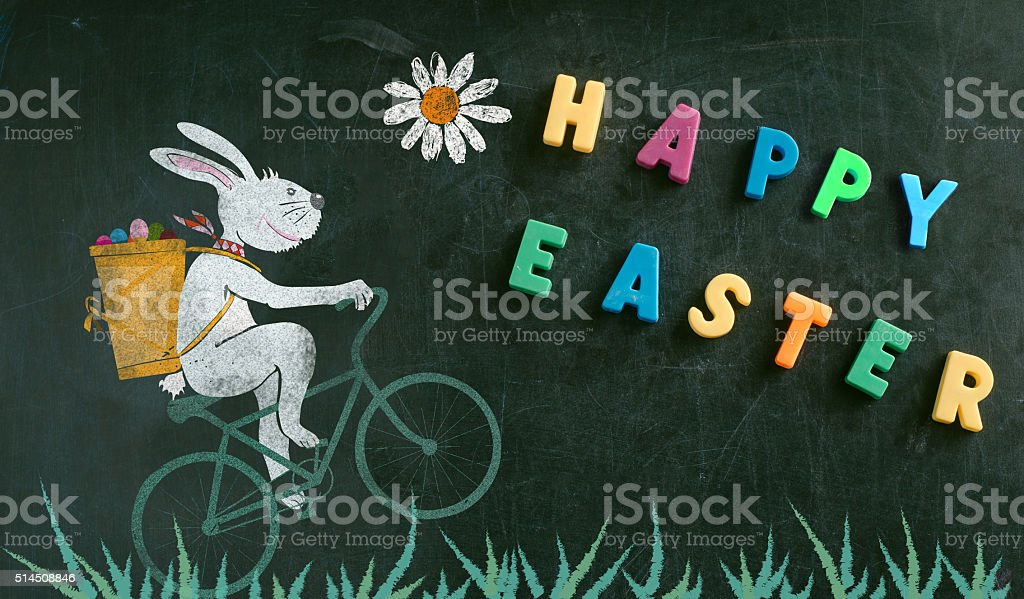 cycling easter bunny on chalk board stock photo