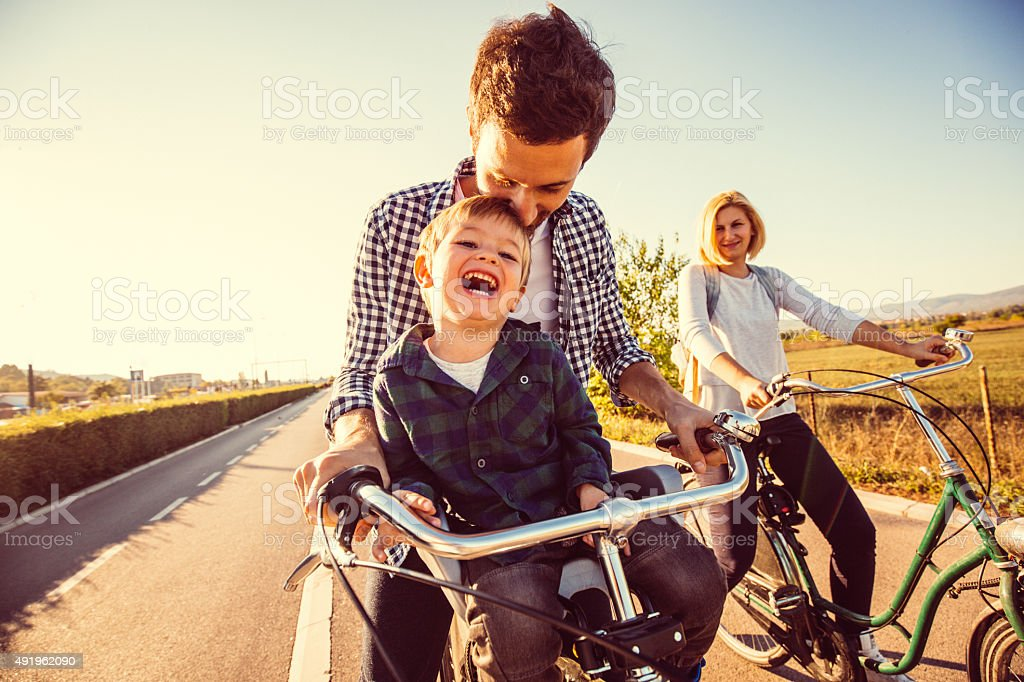 Cycling family stock photo