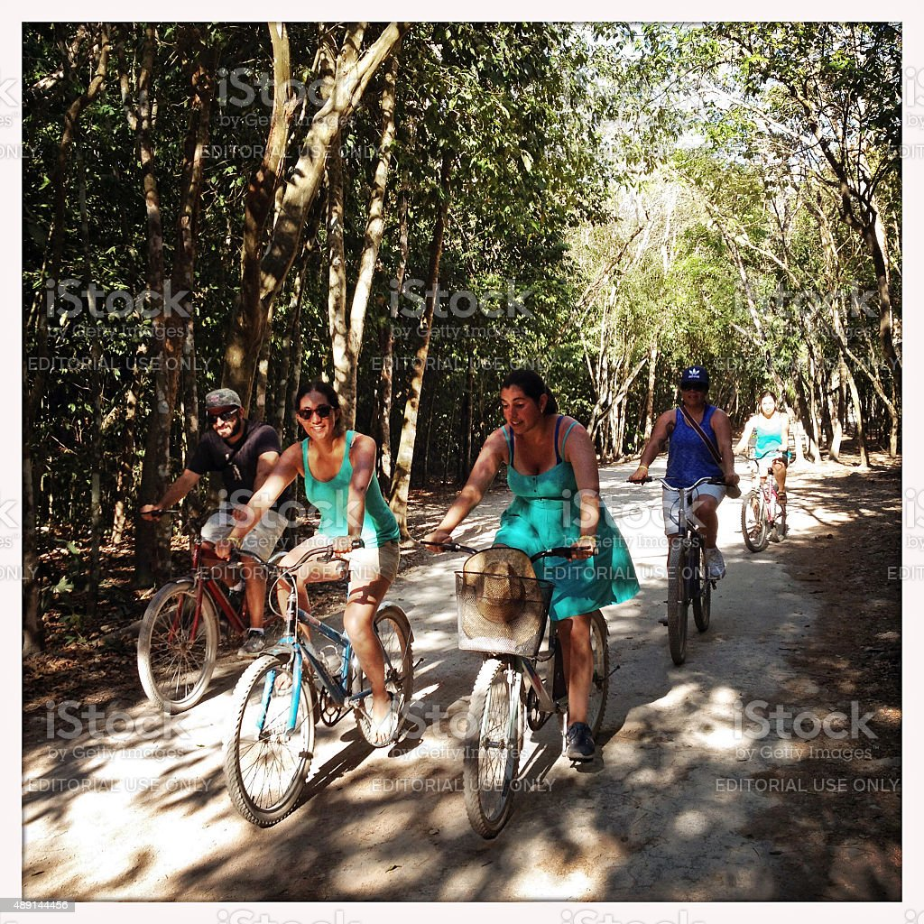 Cycling in archaeological aerea in Coba, Mexico stock photo
