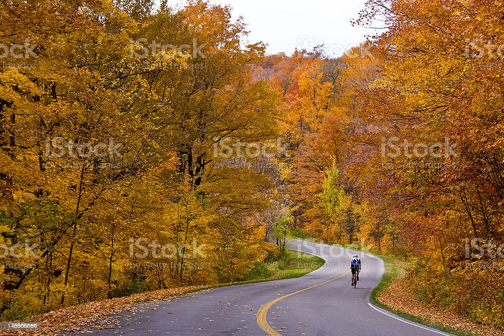 cycling in fall stock photo