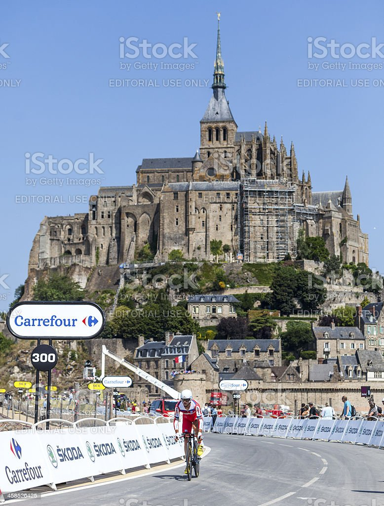 Cycling in Front of Le Mont Saint Michel royalty-free stock photo