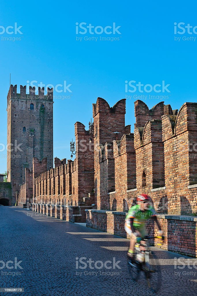 Cycling on Castelvecchio Bridge, Verona royalty-free stock photo