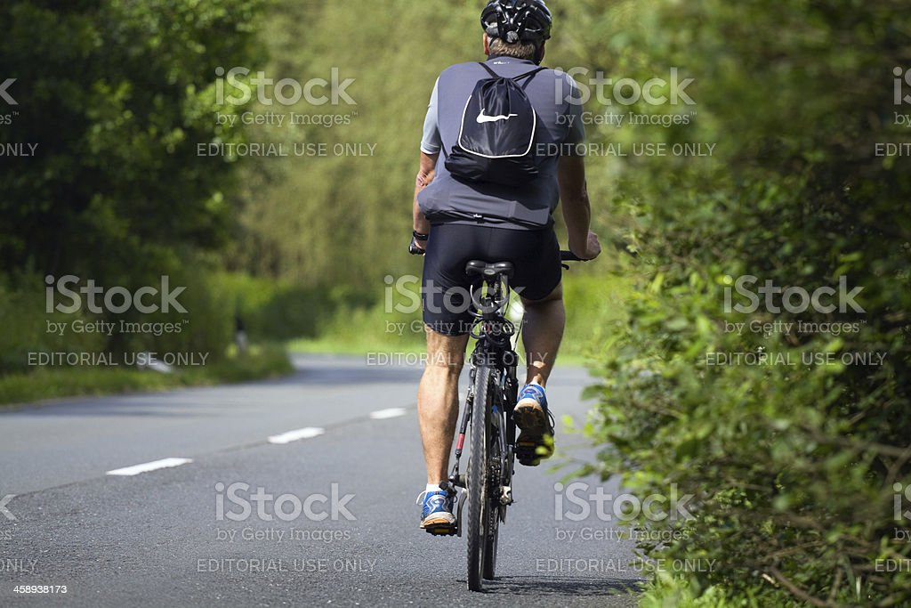Cycling on road stock photo