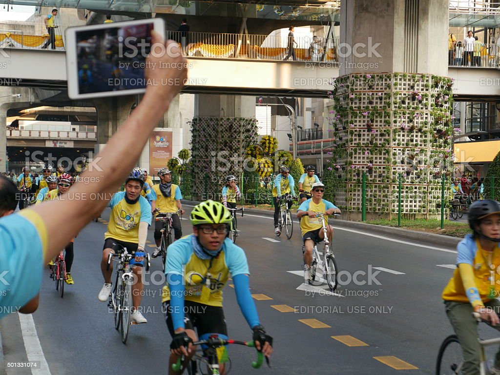 Cycling on roads of Bangkok stock photo